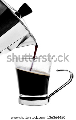 a cup with coffee served from a steel moka pot on a white background