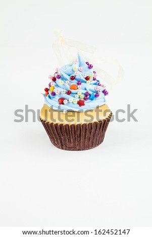 A cupcake ornament against a white background