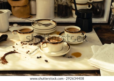 A cups with cappuccino or coffee milk for breakfast served on a  kitchen marble table. Rustic style. Toned image