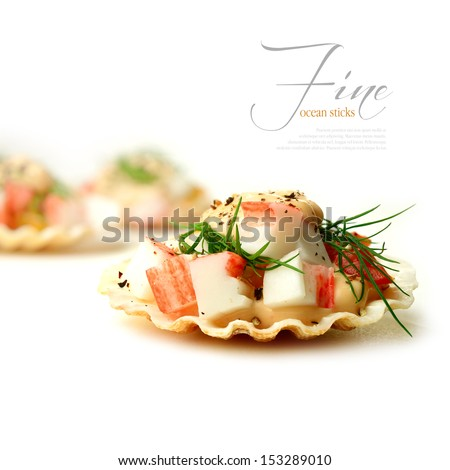 A curated image from my FINE series set. Fresh crab sticks on shellfish shells with dill and seafood sauce against a white background. The perfect image for a fish restaurant menu. Copy space. - stock photo
