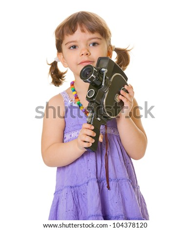 A curious child with an old movie camera in his hands isolated on white background