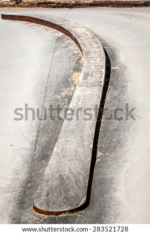 a curve low fence on the road - stock photo