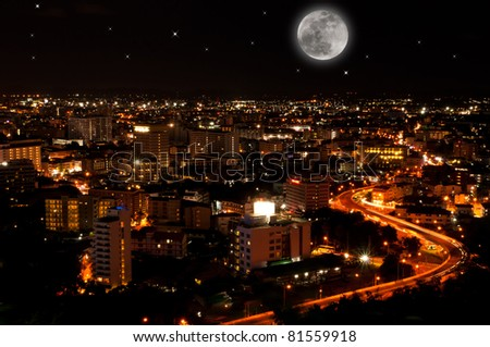 a curve road in Pattaya city at night time with the big full moon, famous place in thailand - stock photo