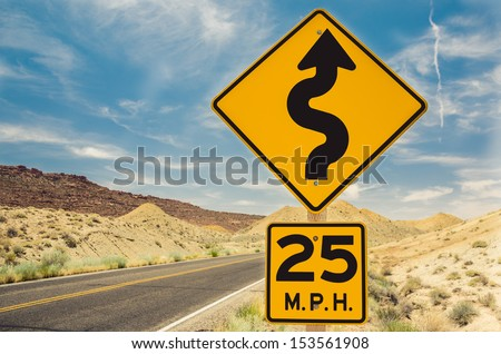 A Curvy road Sign in Arches National Park, Utah - stock photo