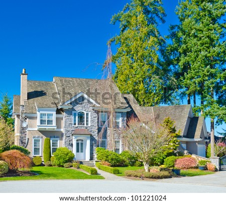 A custom built luxury  house in a residential neighborhood. North America. - stock photo