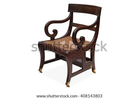 A cut-out of an antique wooden armchair with rattan wicker seat.