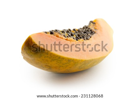 a cut papaya fruit and dried papaya pieces