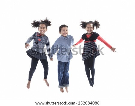 A cute african american little boy jump isolated on white background - stock photo