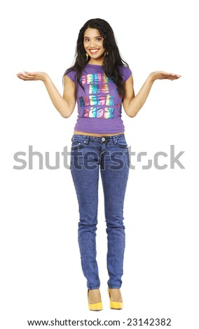 A cute African American woman, holding her hands out as if balancing or weighing something. - stock photo