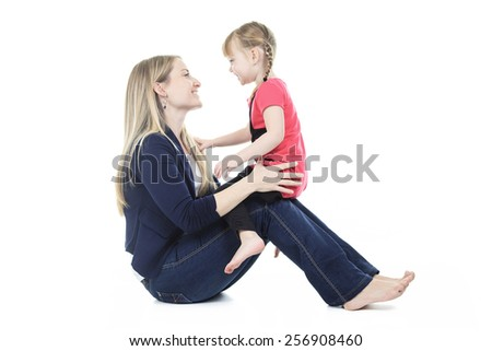 A cute blond, mother with his little girl in front of a white background