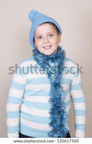 A cute boy in a blue hat - stock photo