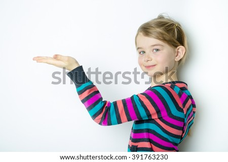A cute cheerful  little girl portrait, isolated on gray background - stock photo