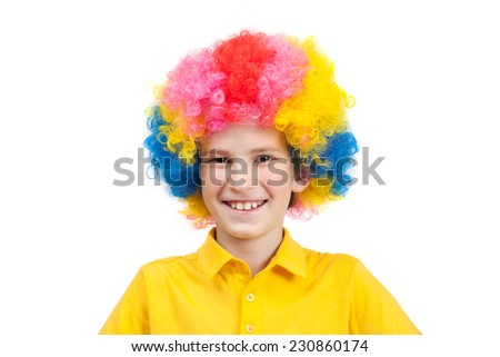 A cute child dressed up in a clown costume and smiling - stock photo
