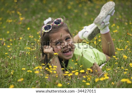 A cute child in meadow - stock photo