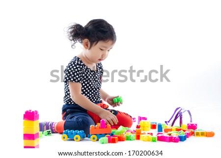 A cute child playing blocks toy on white background, Studio shot - stock photo