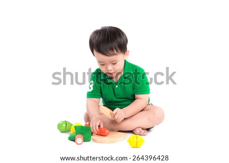 A cute child playing blocks toy on white background, Studio shot