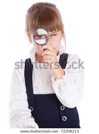 a cute girl is looking through the loupe. isolated on a white background