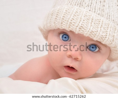 Mixed Newborn Baby Girls With Blue Eyes A cute little baby is looking