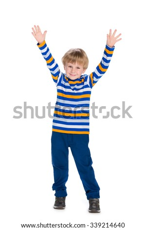 A cute little boy holds his hands up - stock photo