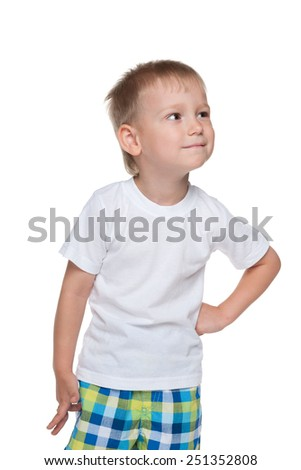 A cute little boy in a white shirt imagines on the white background