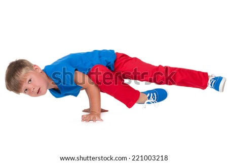 A cute little boy is dancing on the white background - stock photo