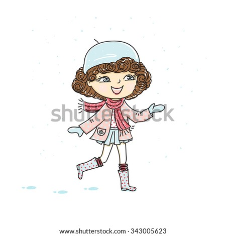 A cute little girl catches snow.