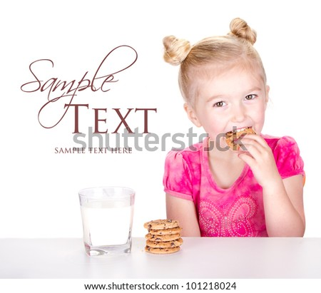 A cute little girl eating a chocolate chip cookie isolated on a white background