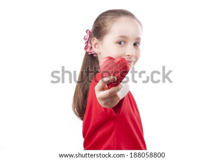 a cute little girl holding red heart in hand on a white background