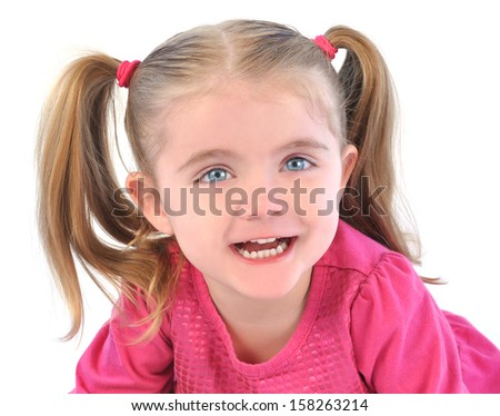 A cute little girl is laughing and smiling on a white isolated background with pig tails for a happiness or childhood concept. - stock photo