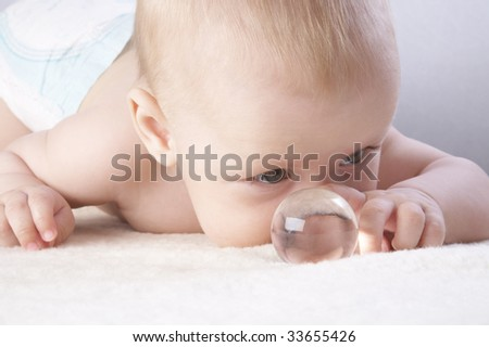 A cute newborn baby crawling on blanket