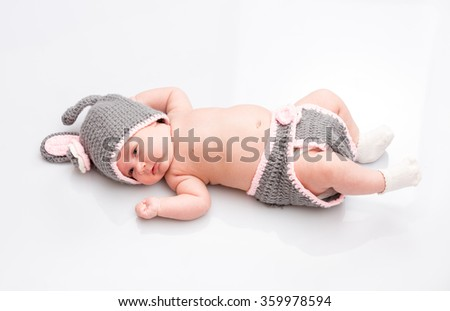 A cute newborn little baby girl . Use it for a child, parenting or love concept. - stock photo