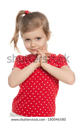 A cute preschool girl against the white background - stock photo