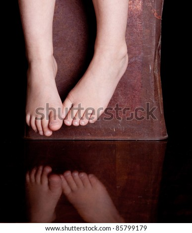 A cute symbolic image of two feet and there reflection.