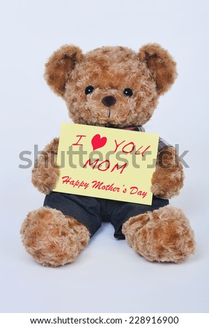 A cute teddy bear holding a yellow sign that says I love mom for Mothers Day isolated on a white background - stock photo