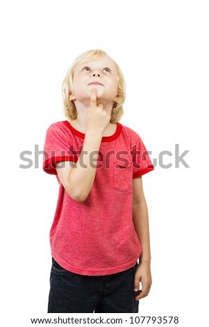 A cute young boy is thinking and looking up at copyspace. Isolated on white - stock photo