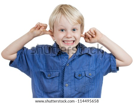 A cute young boy smiling and sticking his fingers in his ears. Isolated over white. - stock photo