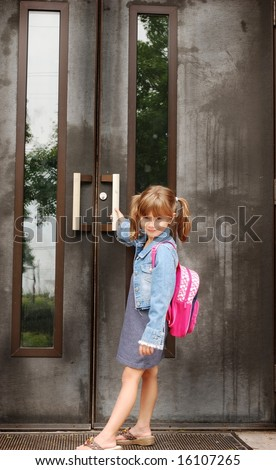 A cute young girl going to school - stock photo