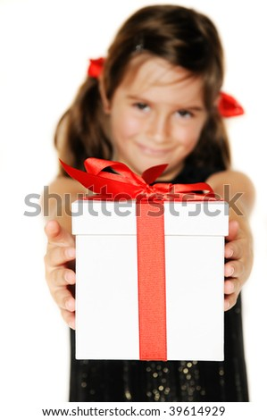 A cute young girl holding a christmas gift, shallow depth of field with focus on box - stock photo