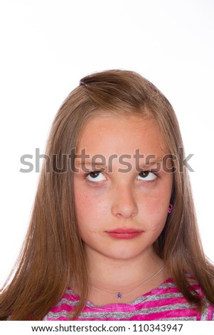 A cute young girl in front of an isolated white background.