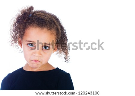 A cute young girl with a sad frown on her face - stock photo