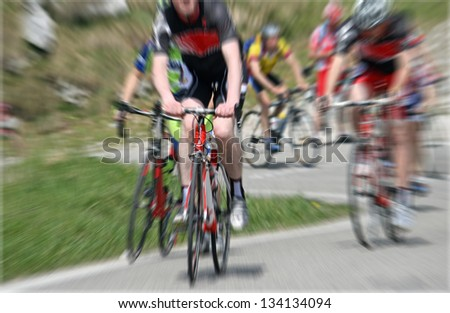 A cycling race with cyclist riding - stock photo