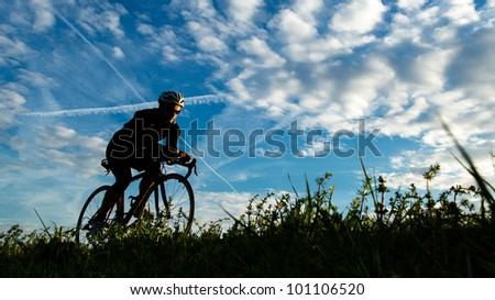 a cycling triathlete - stock photo