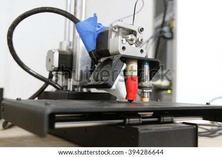 A 3 D printer prints out a miniature stool - stock photo