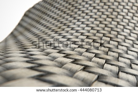 A 3D render of a microscopic view of a stained and dirty simple woven textile on a white background
