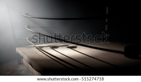 A 3D render of an old vintage boxing ring surrounded by ropes spotlit dramatically on one corner on an isolated dark background