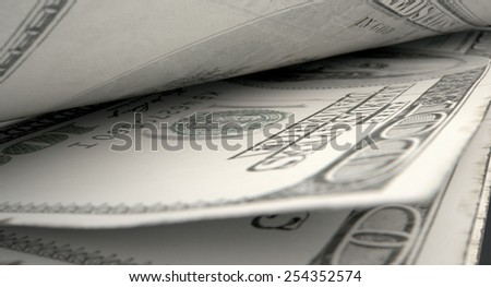 A 3D rendering of a macro close-up view showing the detail in between two separated banknotes
