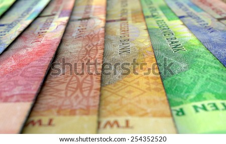 A 3D rendering of a macro close-up view showing the detail of south african rand banknotes laid out and overlapping in a staggered row - stock photo