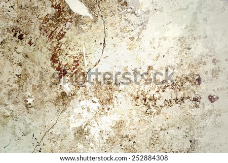 A damaged red clay brick wall textured - stock photo