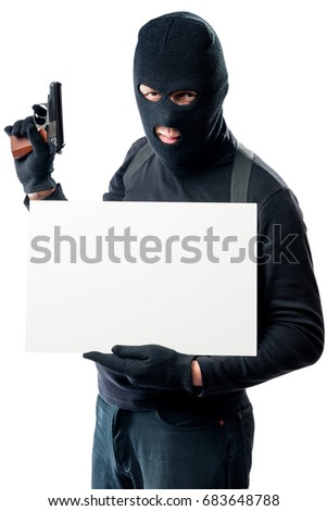 A dangerous armed bandit holding an inscription poster