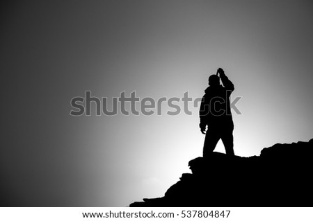 A dark hiker person silhouette on the top of peak in Pirin national park in Bulgaria